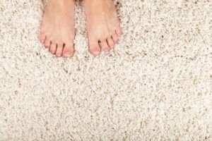 barefoot on clean carpet
