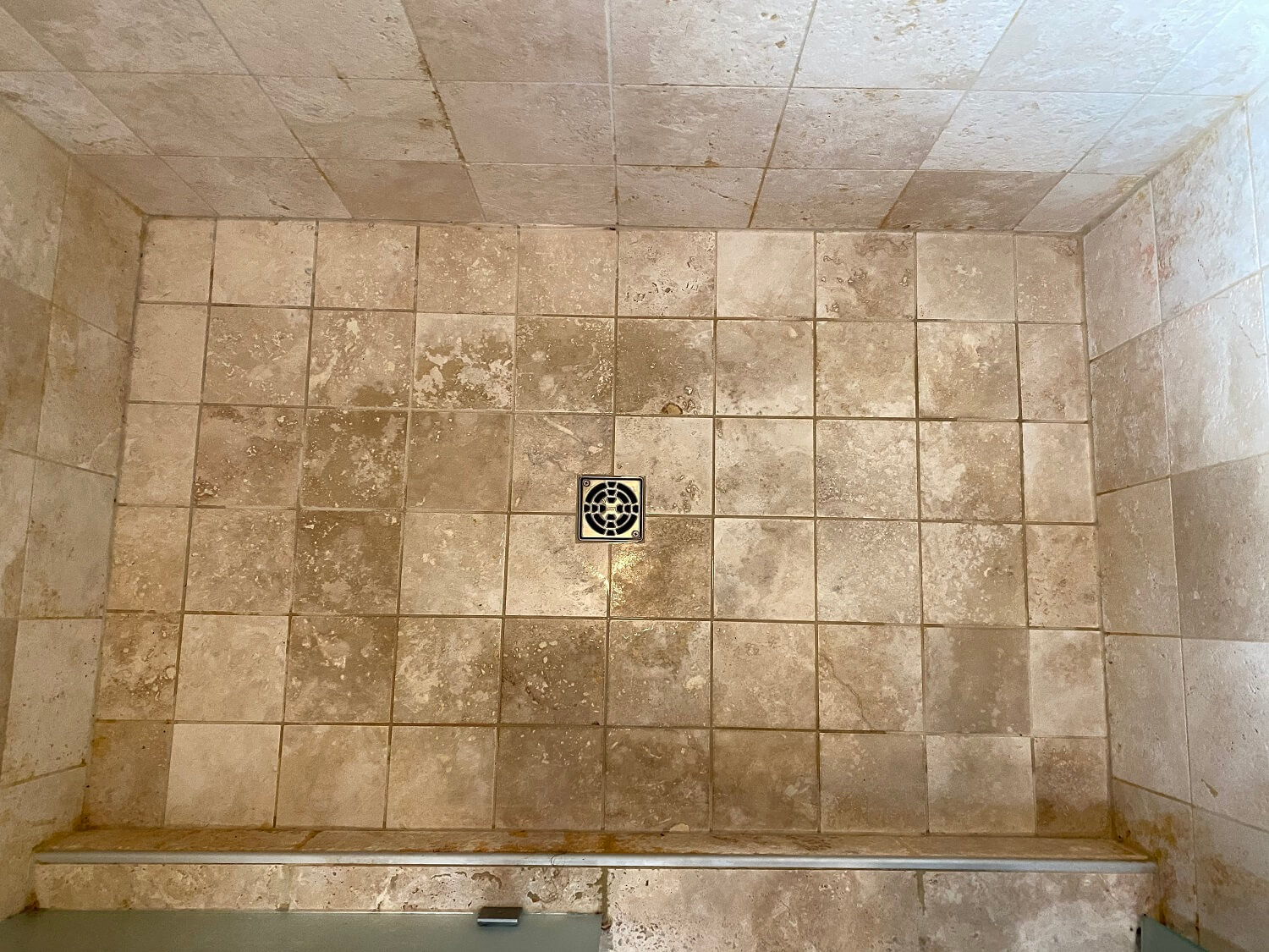 travertine shower floor before deep clean