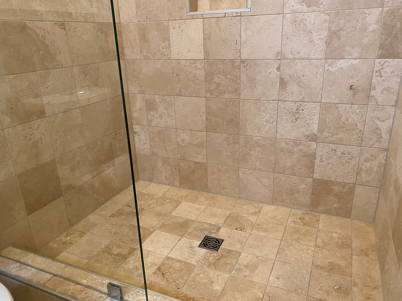 travertine shower stall after deep clean